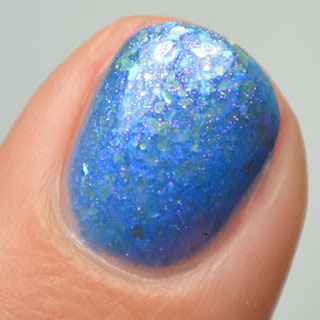 blue nail polish with flakies and shimmer
