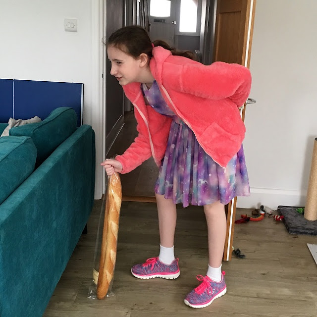 sasha using a baguette as a walking stick