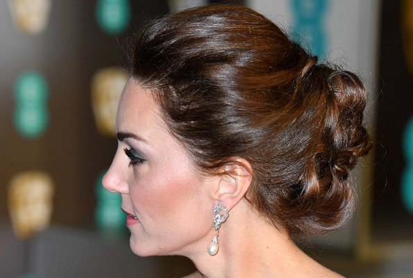 Kate Middleton, the Duchess of Cambridge wearing Princess Diana's pearl earrings, Jenny Packham one shoulder gown