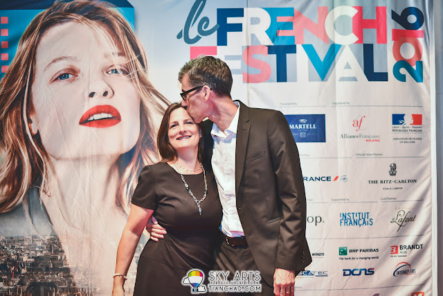 Striking a loving pose at the 2016 le French Festival launch in GSC PKL is husband and wifeMs Brigitte Laberge and Mr John Kidd