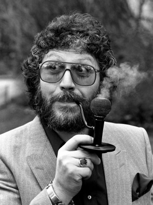 BBC DJ Dave Lee Travis, originally a Pirate Radio DJ, smoking a mini bong. Pirate Radio and Sealand and Other stories of Rock, Radio, and Regulations. Marchmatron.com
