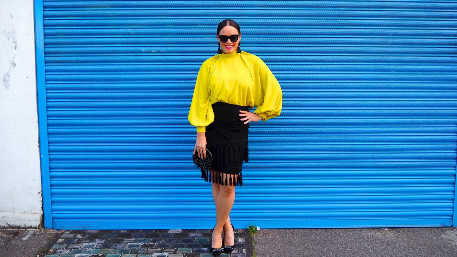 Neon Yellow Balloon Sleeve Blouse, Black Tasseled Skirt and Jewelled Heels