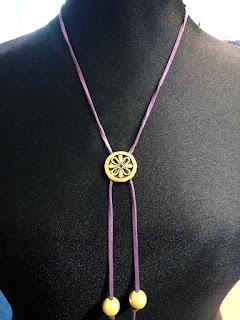 rawhide strap pendant