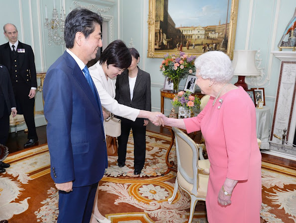 Queen Elizabeth of Great Britain hosts a private audience with Japanese Prime Minister Shinzo Abe, and his wife Akie at Buckingham Palace