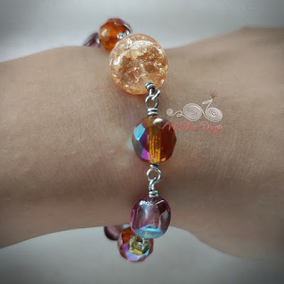 Wire Wrapped Fire Polished Glass Beads Bracelet on Wrist