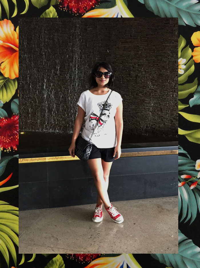 Dayle Pereira, the fashion blogger at Style File showcases her personal style with a New Look tshirt, Selfridges shorts, Forever 21 sunglasses, Reiss quilted bag and converse all star sneakers