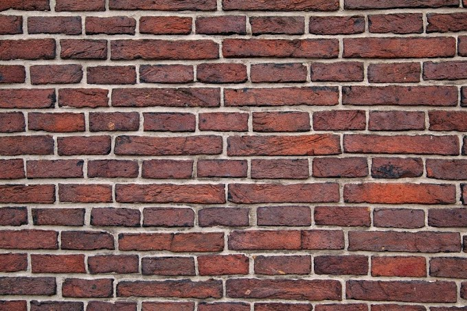 THE BRICK WALL CONSTRUCTION