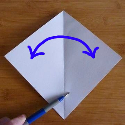 Folding the paper in half diagonally