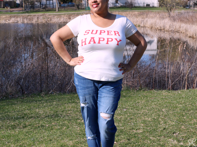a woman wearing a t-shirt that says super happy