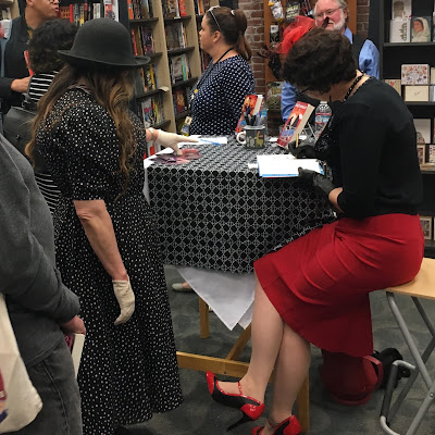 In Red & Black Pencil Dress in Alameda for the Launch of Reticence