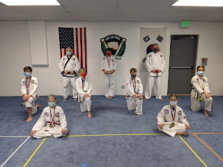 A group of taekwondo martial arts in a class for adults and children