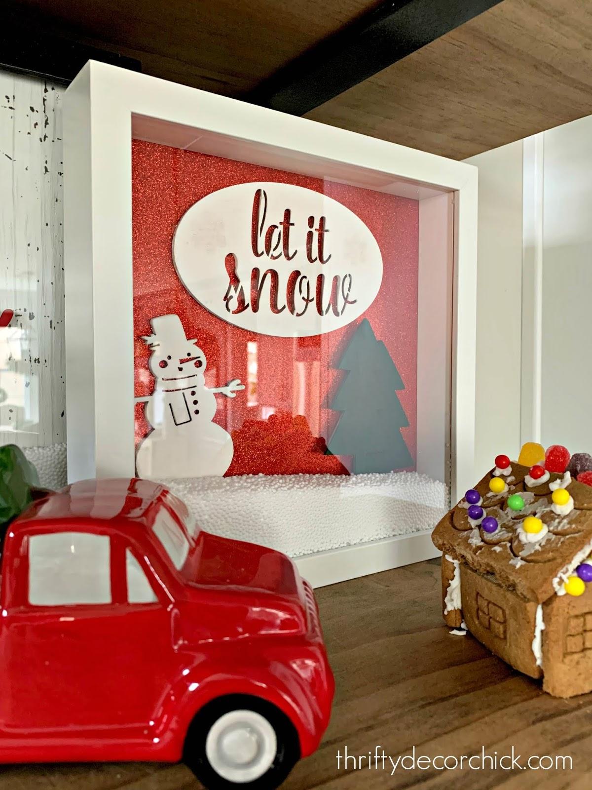 Making snowglobe art in frame