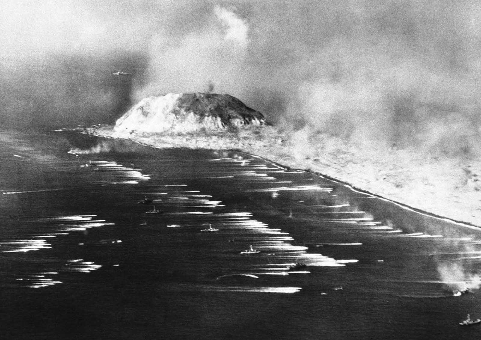 U.S. Marines going ashore at Iwo Jima, a Japanese Island which was invaded on February 19, 1945. Photo made by a Naval Photographer, who flew over the armada of Navy and coast guard vessels in a Navy search plane.