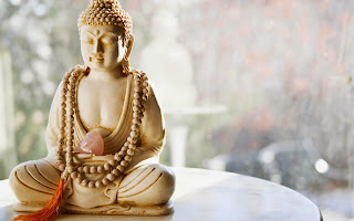 cute-little-buddha-statue-white-background-peace-image.jpg