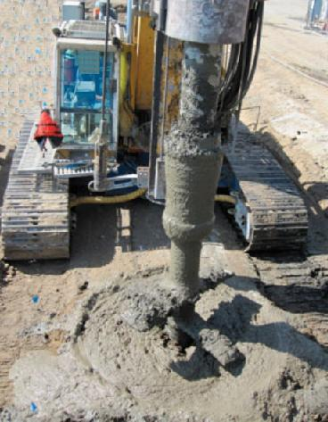 Soilcrete column construction to provide additional support Earth retaining structure