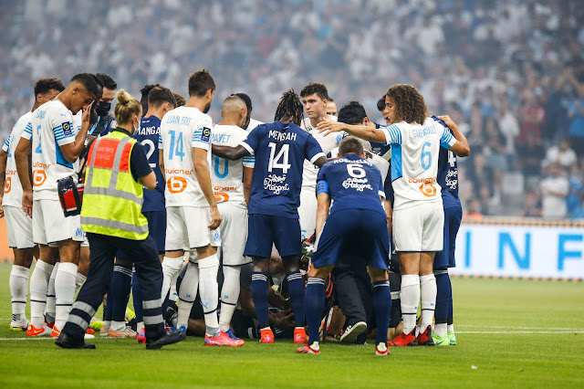 Bordeaux and Marseille players gather around Samuel Kalu after the Nigerian collapsed during a Ligue 1 match
