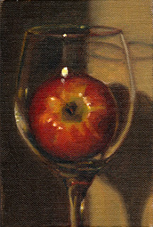 Oil painting of a red apple in a wine glass.