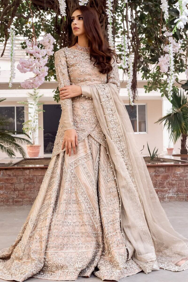 Kundan net wedding dress with short overlapping shirt, flared sharara and kundan net dupatta