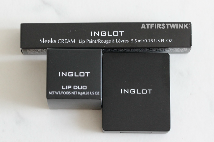 INGLOT Sleeks Cream Lip Paint, the INGLOT Lip Duo, and a single eyeshadow in the Freedom palette with mirror