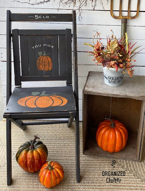 Photo of a wooden folding chair painted and stenciled as fall decor