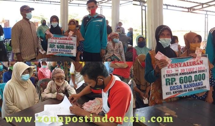Kepala Desa Kandang H. Kusnadin Birri, Salurkan BLTDD Kepada KPM Di Balai Desa Kandang