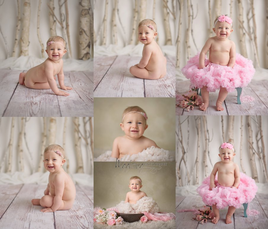 One year old baby girl milestone session in a studio with a cake smash