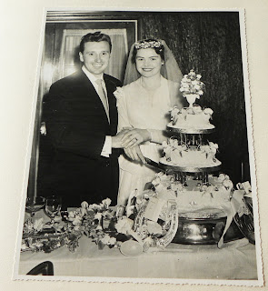 Bride and groom with cake 1957