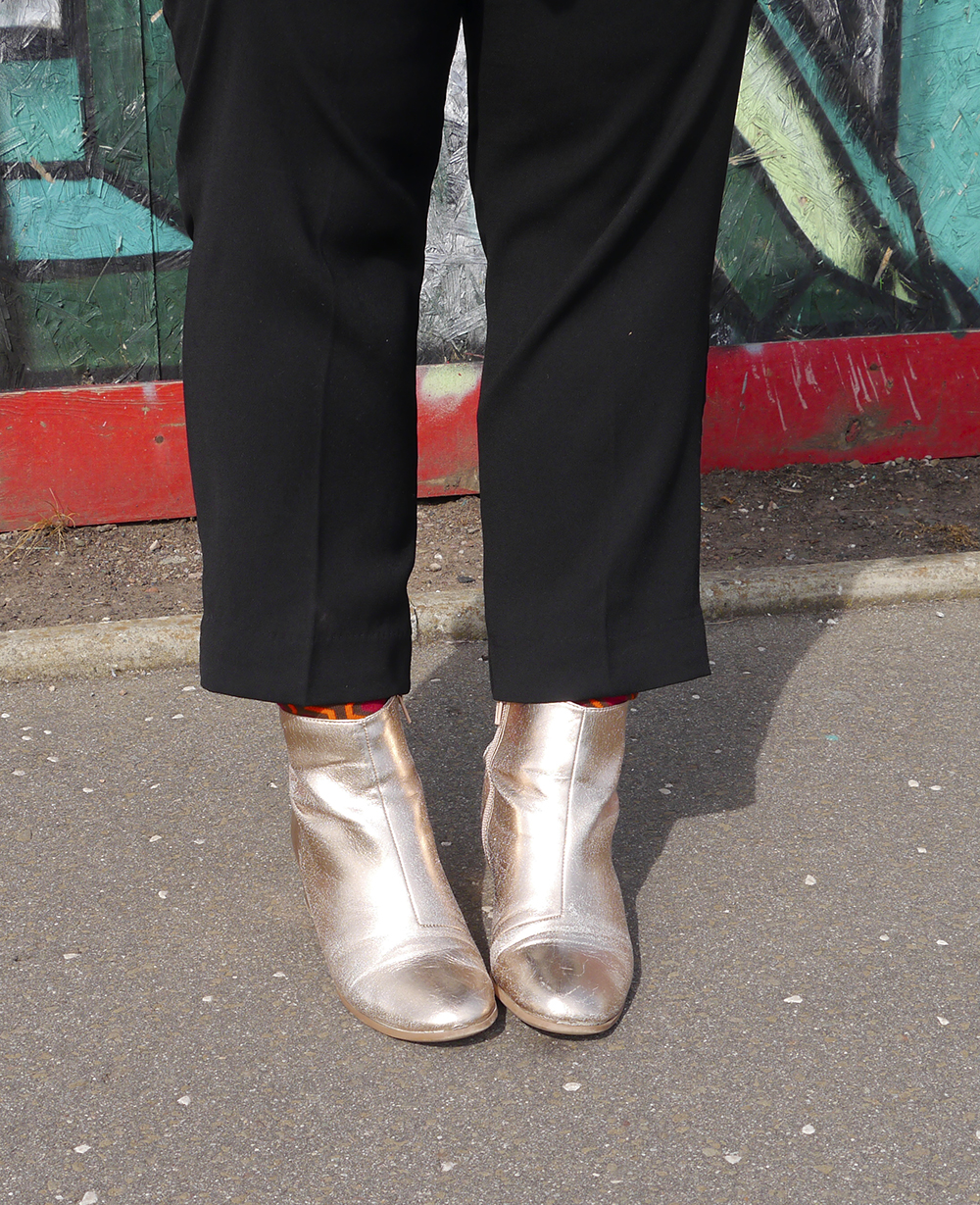 Dundee blogger Helen from Wardrobe Conversations wears black trousers with The Shinin patterned socks from DCA Shop and metallic Primark boots