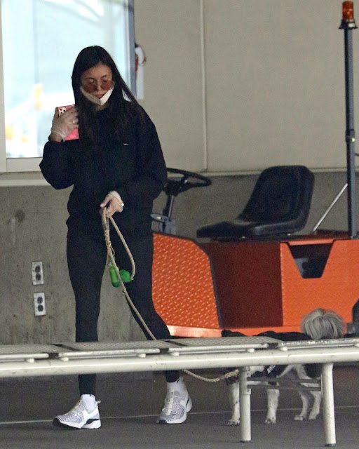Nina Dobrev Arrives at Airport in Vancouver  9 Nov-2020