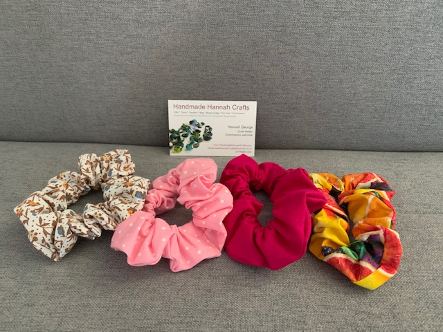 Four hair scrunchies in different colours and prints