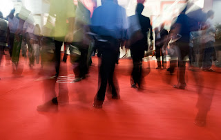 Fast-moving crowd on trade show floor