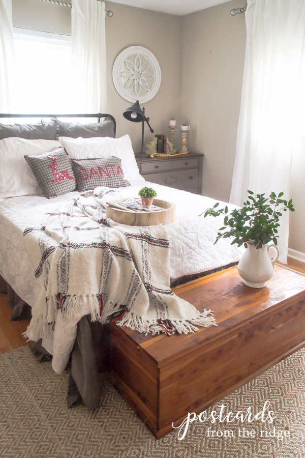 cozy bedroom with cedar trunk and architectural salvage mirro
