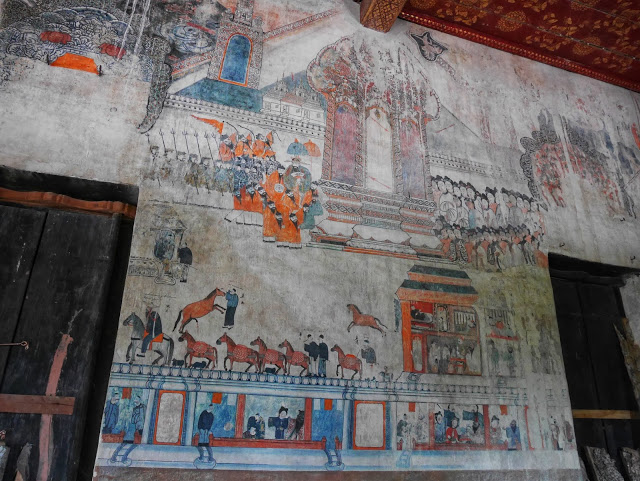 murals at a temple in Luang Prabang