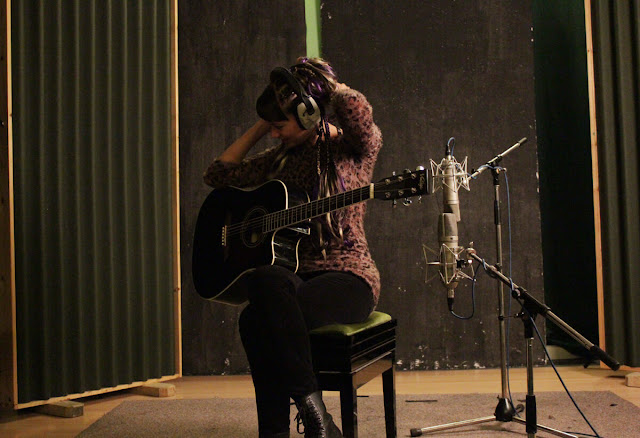 Anna-Christina from Lilygun recording acoustic guitar