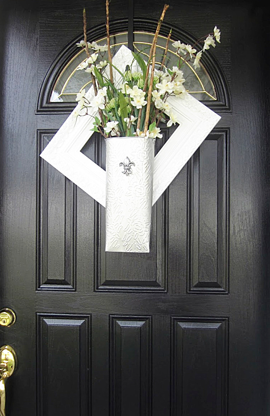 black front door with arched window and flowers