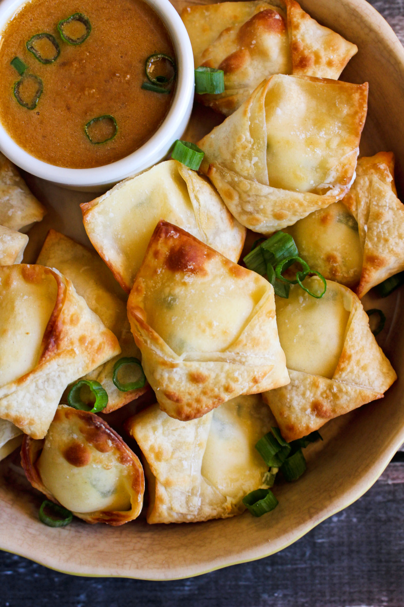 Air Fryer Wontons are crisp wonton pouches filled with a smooth cream cheese filling. They are way healthier than fried wontons and cook in just three minutes! #airfryerrecipes #wontons