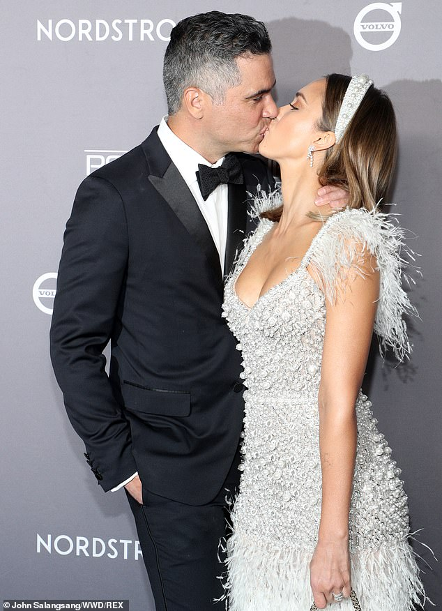 Jessica Alba shares romantic kiss with hubby Cash Warren as she mingles with starry guest list of fellow celebrity moms at Baby2Baby gala