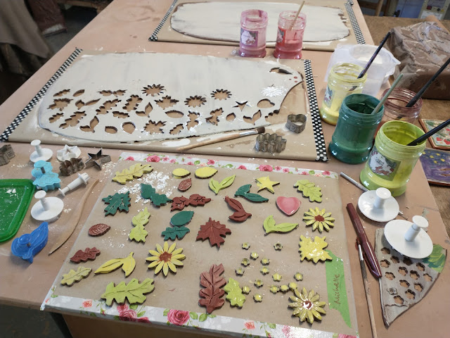 My clay cut-out shapes ready glazed for firing
