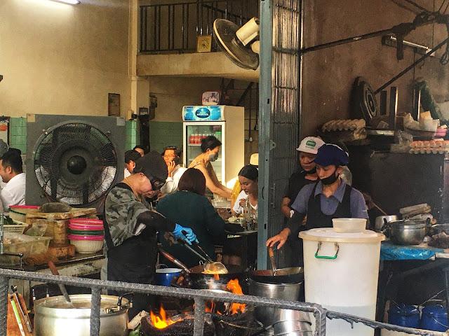 Jay Fai cooking over a hot wok