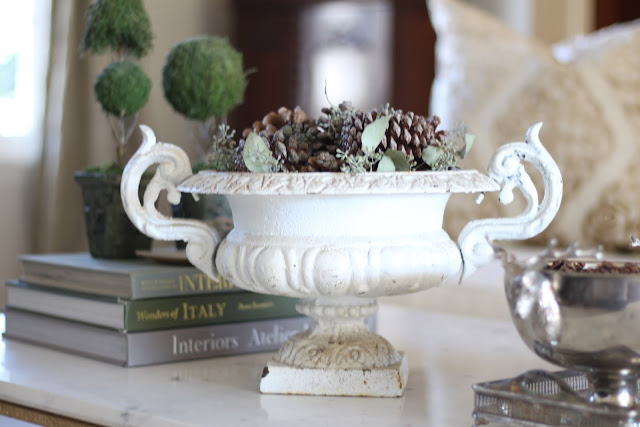 styling a coffee table antique urn pinecones topiaries christmas