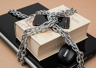 A book chained to a computer