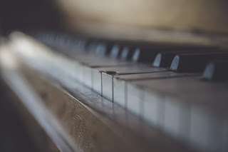 close up of piano keys on a well-loved piano