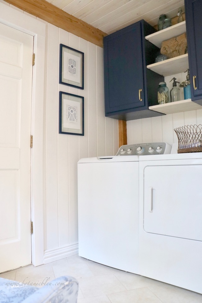 French Country Laundry ORC™ Reveal Navy Cabinets with Open Shelves