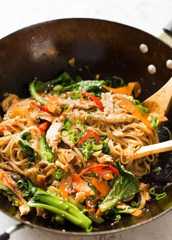 Great fridge forage meal - any dried noodles, any veggies, optional protein. This Chicken Stir Fry with Rice Noodles is healthy and super quick to make!