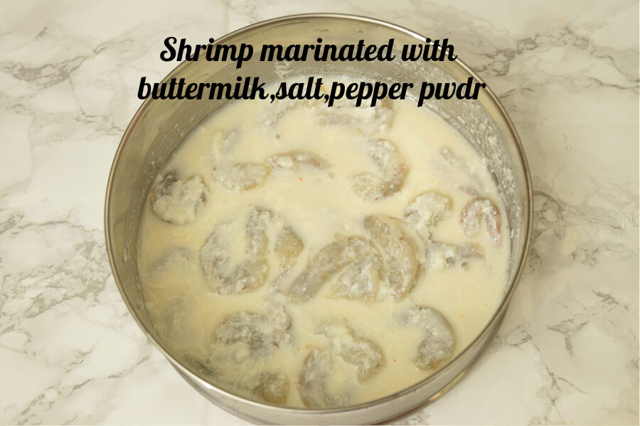 shrimp marinated,salt,pepper pwdr and buttermilk in a bowl