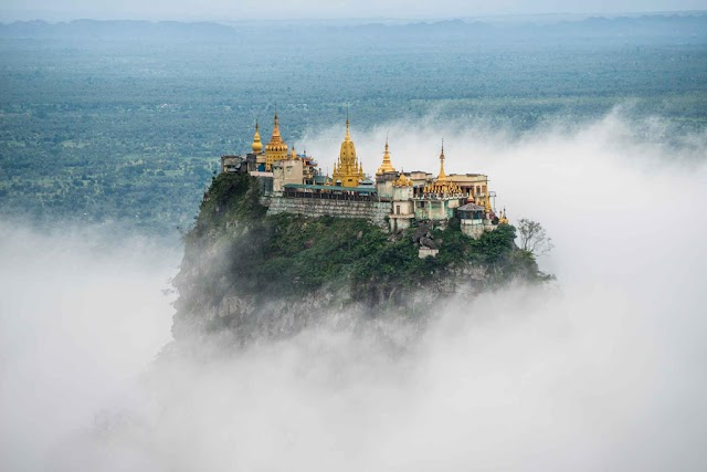 Admire the beauty of the unique Taung Kalat pagoda on the cliff