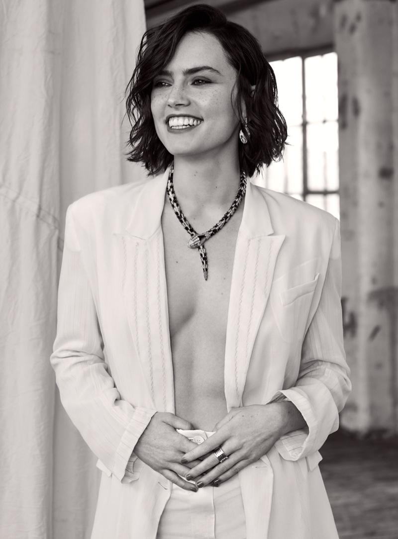 Daisley Ridley wears Salvatore Ferragamo jacket and pants with Bulgari jewelry