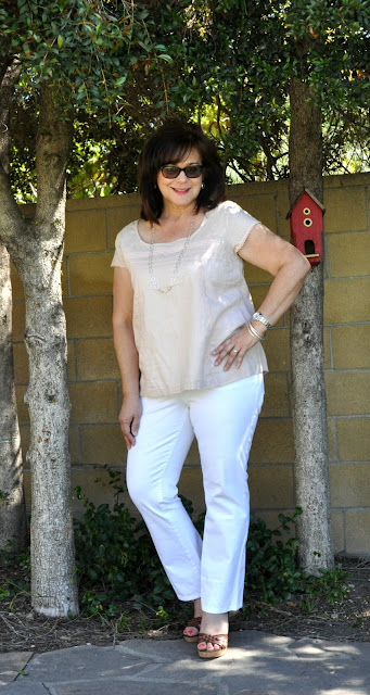 blush top and white jeans