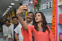 Catherine Tresa in Orange Kurti top and Plazzo at Launches B New MobileStore at Kurnool 10.08.2017 030.JPG