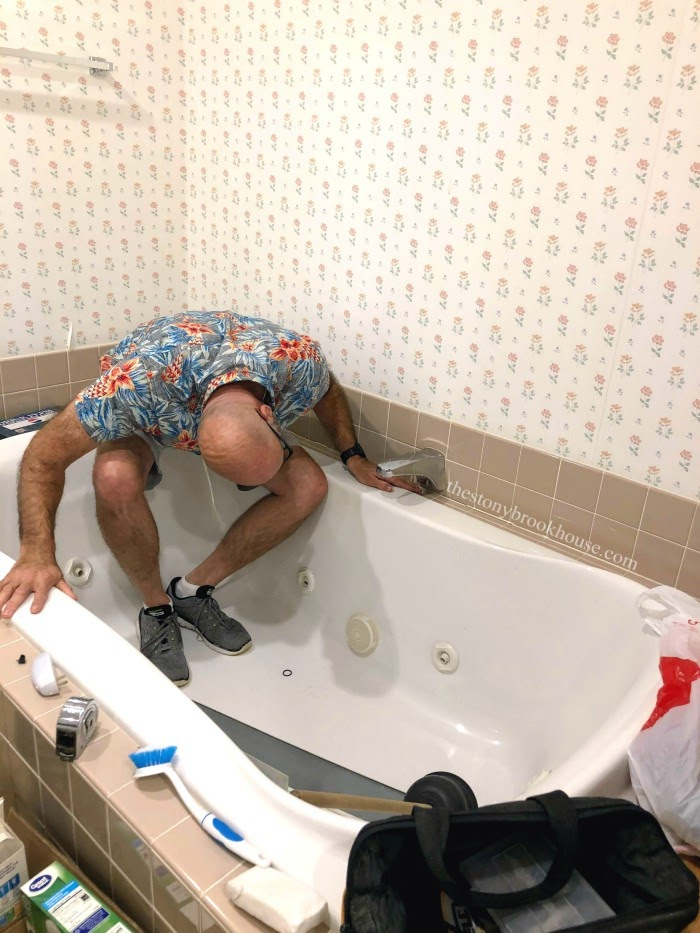 Inspecting jacuzzi tub spout